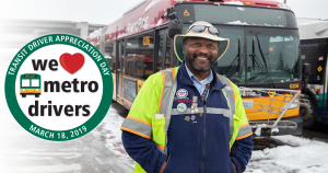 Walid UNderwood, transit operator, poses in front of a snowy bus