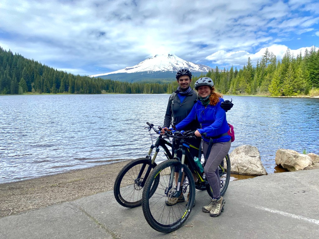 Aaron and Elina model their bikes in front of a lake